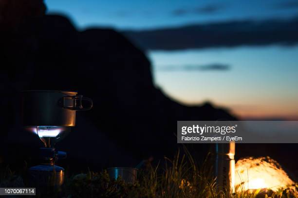 close-up of coffee on stove against sky during sunset - fabrizio zampetti foto e immagini stock
