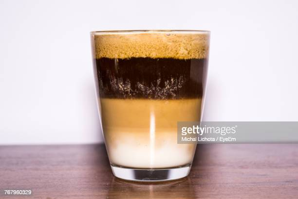 Close-Up Of Coffee On Table Against White Background