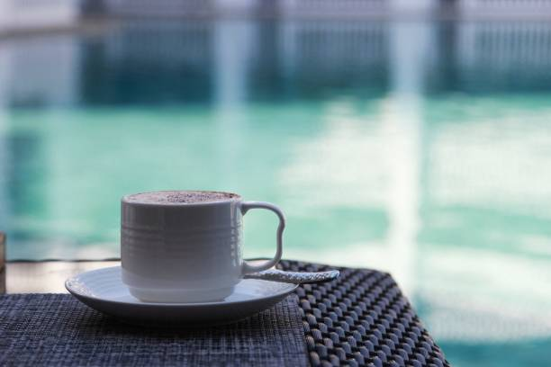 Close-Up Of Coffee On Table By Swimming Pool