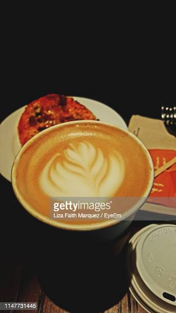 close-up of coffee on table - liza marquez stock pictures, royalty-free photos & images