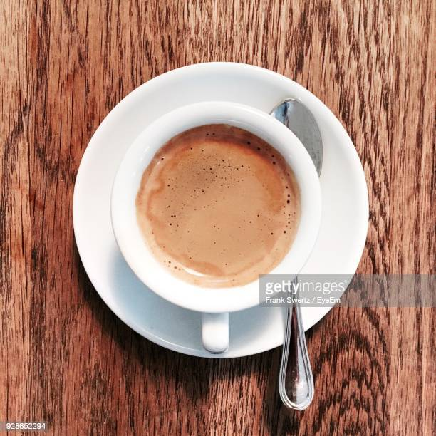 close-up of coffee on table - frank swertz stockfoto's en -beelden