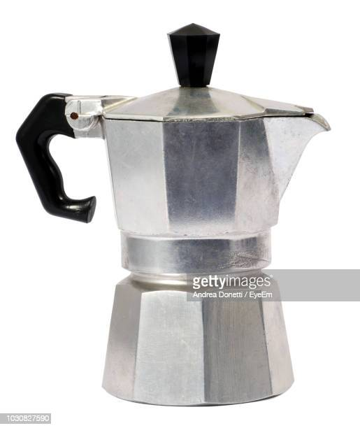 Close-Up Of Coffee Pot Against White Background