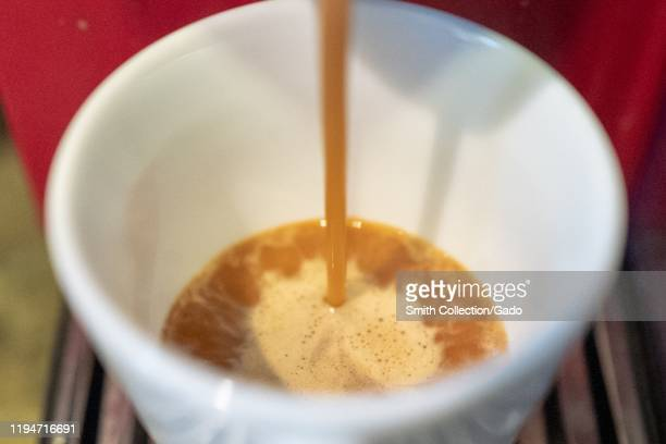 Closeup of coffee pouring from an espresso maker into a small cup San Ramon California December 17 2019 In December of 2019 an industry report from...