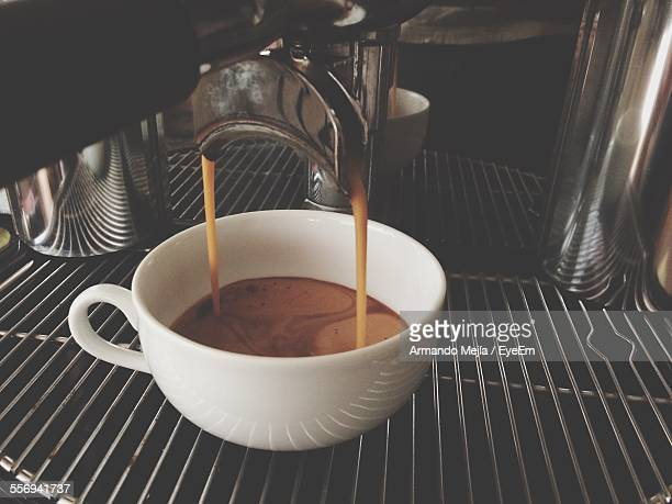 Close-Up Of Coffee Pouring From Espresso Machine