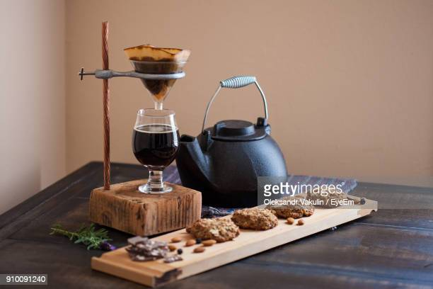 Close-Up Of Coffee With Cookies On Table