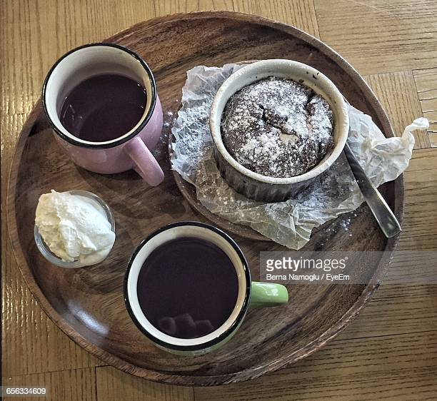 Close-Up Of Coffee With Dessert In Plate On Table