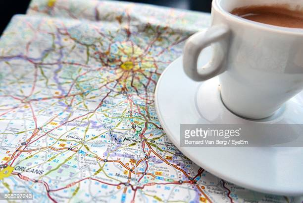 Close-Up Of Coffee With Map On Table