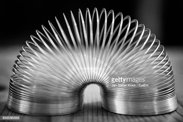 Close-Up Of Coiled Spring On Table