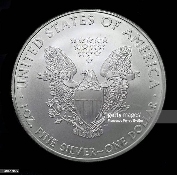 close-up of coin against black background - us coin stock pictures, royalty-free photos & images