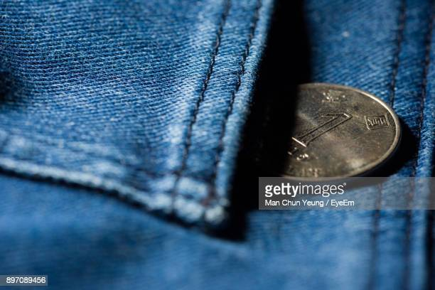 close-up of coin in jeans pocket - pocket stock pictures, royalty-free photos & images