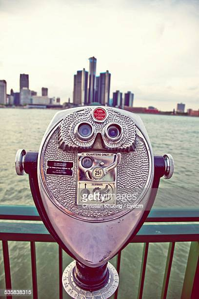 Close-Up Of Coin Operated Binocular Against Sea