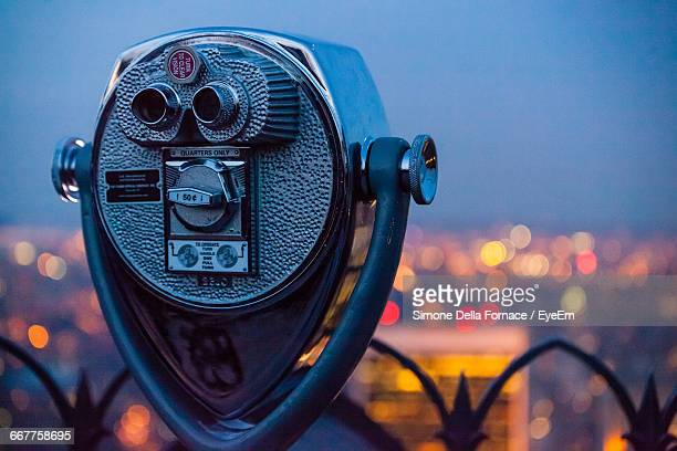 Close-Up Of Coin-Operated Binocular Against Sky At Dusk