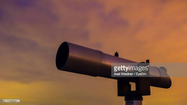 Close-Up Of Coin-Operated Binoculars Against Sky During Sunset