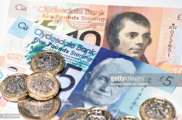 close-up of coins and paper currency - scotland stock pictures, royalty-free photos & images