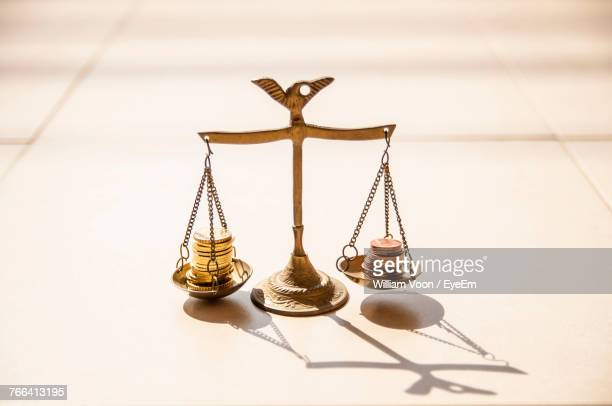 close-up of coins on weight scale - weight scale stock pictures, royalty-free photos & images