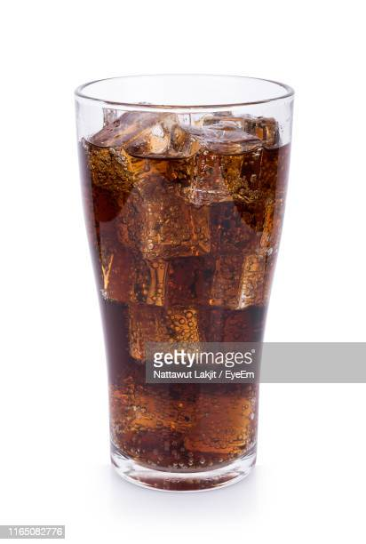 close-up of cola in glass against white background - pepsi stock pictures, royalty-free photos & images