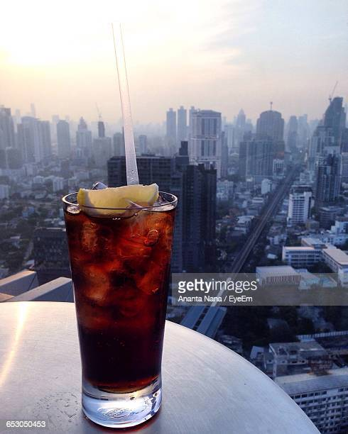 Close-Up Of Cola With Ice Cubes At Octave Rooftop Lounge And Bar