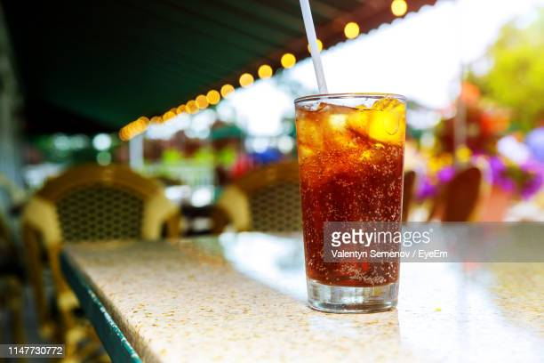 close-up of cold drink on table - cold drink stock pictures, royalty-free photos & images