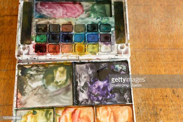 Close-Up Of Color Palette On Wooden Table