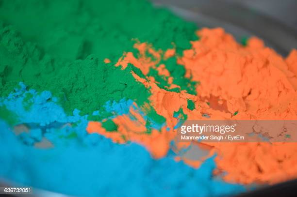 Close-Up Of Color Powder In Container
