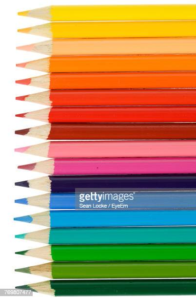 close-up of colored pencils against white background - color pencil stock pictures, royalty-free photos & images