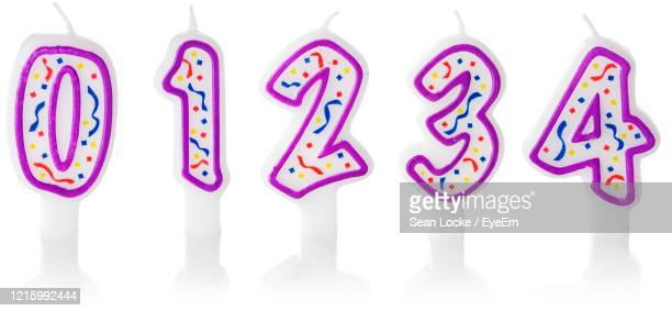 close-up of colored pencils over white background - birthday candle stock pictures, royalty-free photos & images