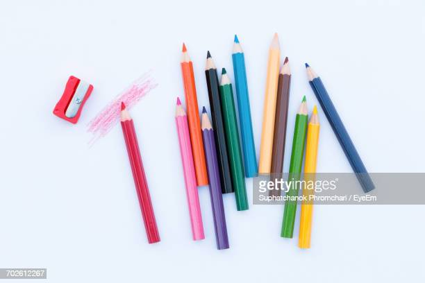 close-up of colored pencils over white background - color pencil stock pictures, royalty-free photos & images