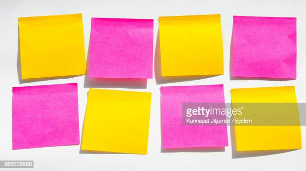 close-up of colorful adhesive notes on white background - adhesive note stock pictures, royalty-free photos & images