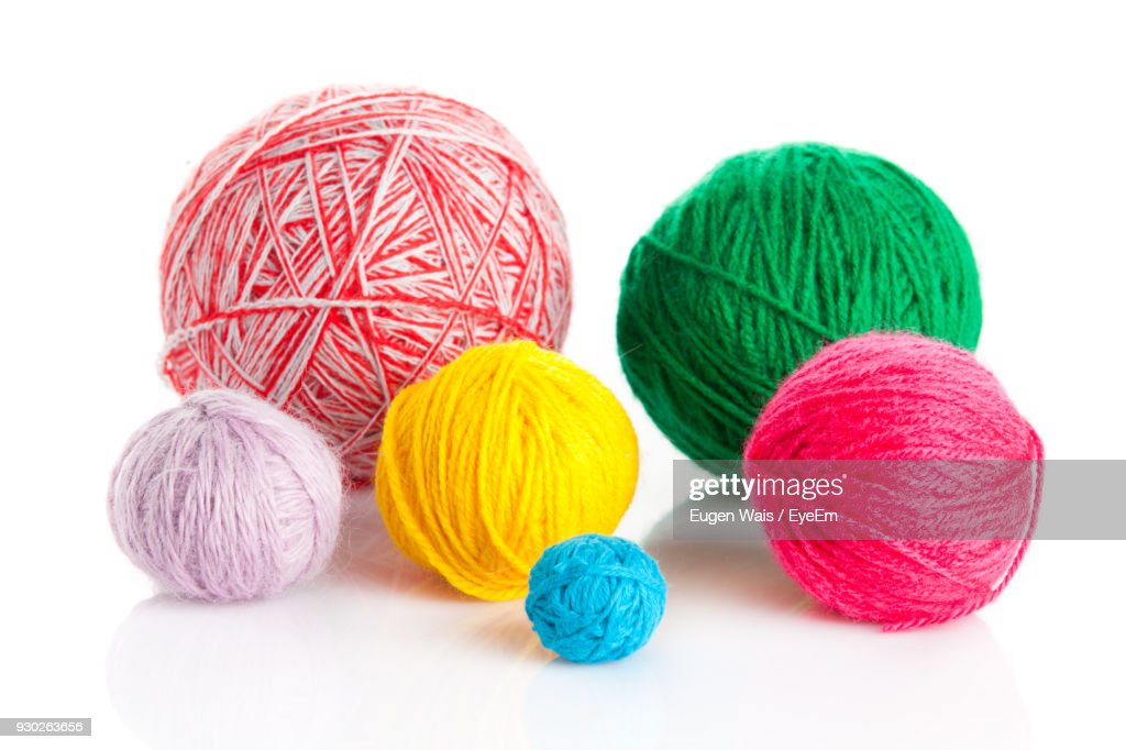 Close-Up Of Colorful Ball Of Wools Against White Background : ストックフォト