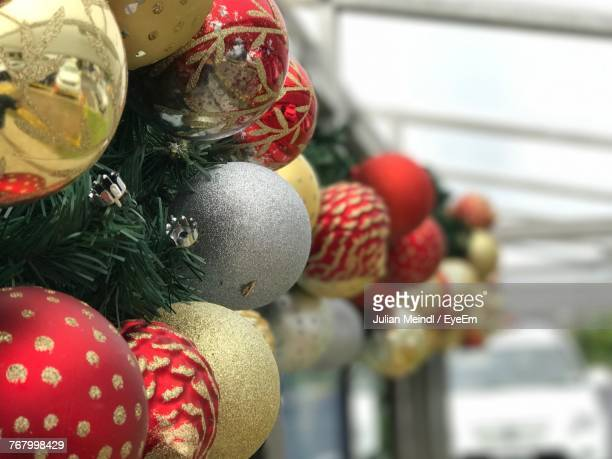 Close-Up Of Colorful Baubles Hanging On Wall