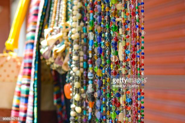 Close-Up Of Colorful Beads Hanging At Market For Sale