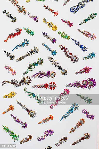 Close-Up Of Colorful Bindis On White Background