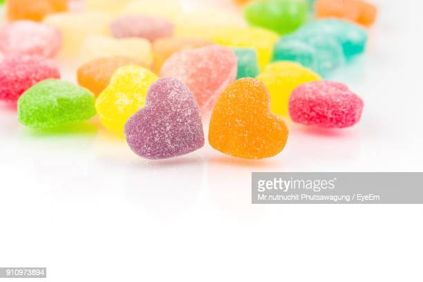 Close-Up Of Colorful Candies Against White Background