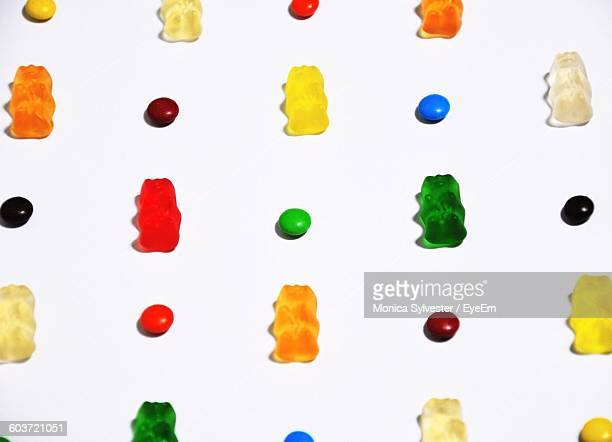 close-up of colorful candies and gummi bears on white background - gummi bears fotografías e imágenes de stock