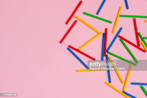 close-up of colorful chalks over pink background - chalk art equipment stock pictures, royalty-free photos & images