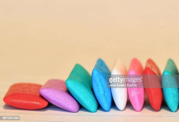 close-up of colorful chewing gums on table - jose ayala stock pictures, royalty-free photos & images