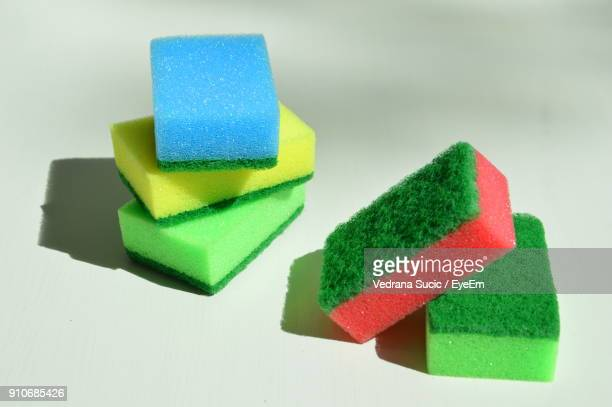 Close-Up Of Colorful Cleaning Sponge On White Background