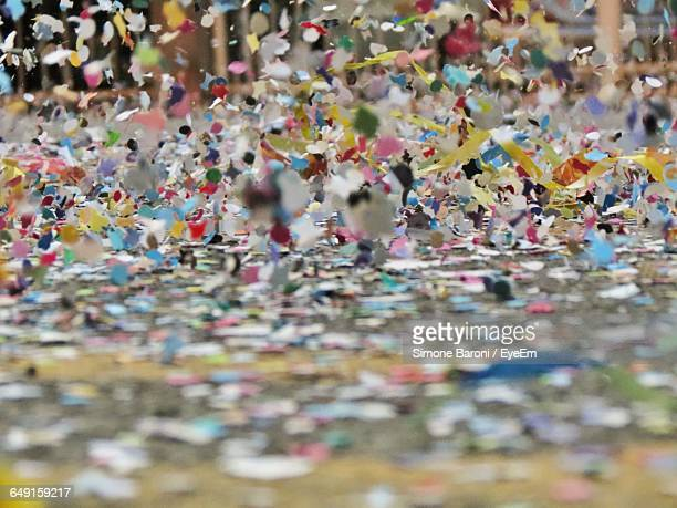 Close-Up Of Colorful Confetti Falling On Floor