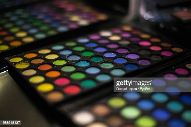 Close-Up Of Colorful Cosmetic Palette By Mirror