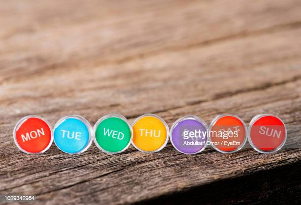 close-up of colorful days of week on table - tuesday stock photos and pictures