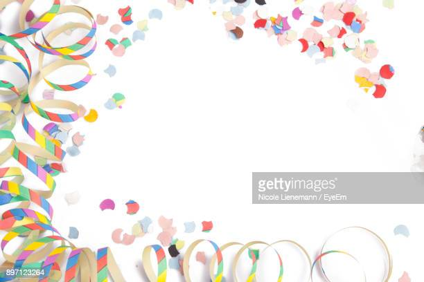 close-up of colorful decoration over white background - streamer stock pictures, royalty-free photos & images