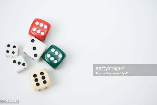 close-up of colorful dices over white background - dice stock pictures, royalty-free photos & images