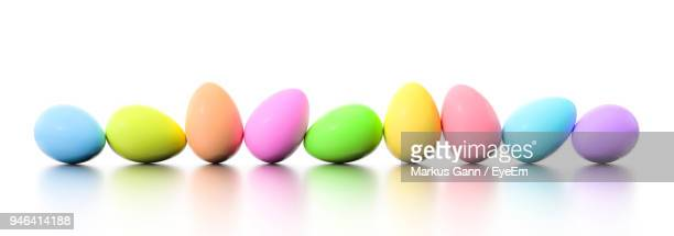 Close-Up Of Colorful Easter Eggs Against White Background