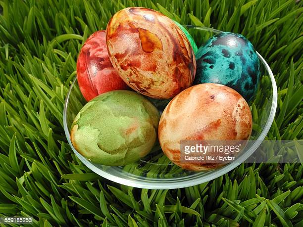 Close-Up Of Colorful Easter Eggs In Plate On Grass