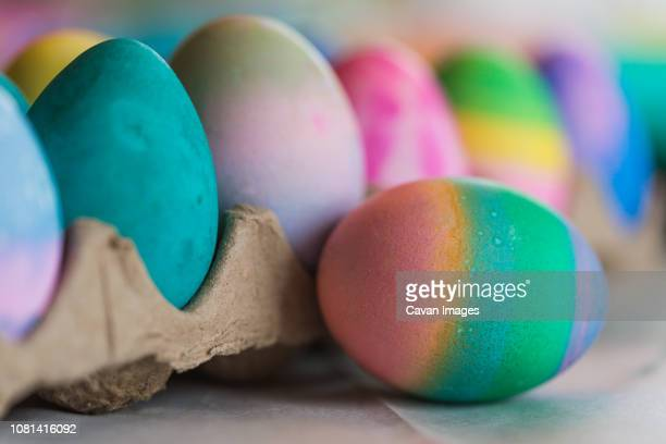 close-up of colorful easter eggs on table at home - art and craft stock pictures, royalty-free photos & images