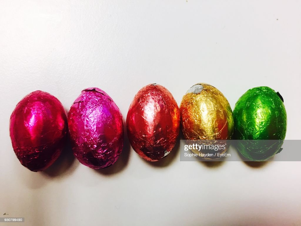 Closeup Of Colorful Easter Eggs On White Table High Res Stock