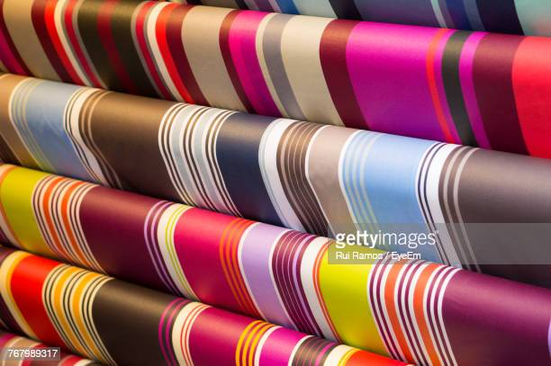 close-up of colorful fabrics for sale in store - saint jean pied de port stock photos and pictures