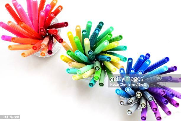 Close-Up Of Colorful Felt-Tip Pens In Container Over White Background