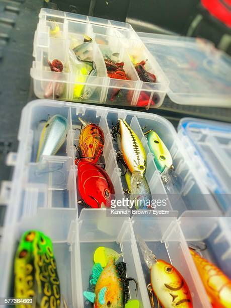 Close-Up Of Colorful Fishing Hooks In Plastic Box