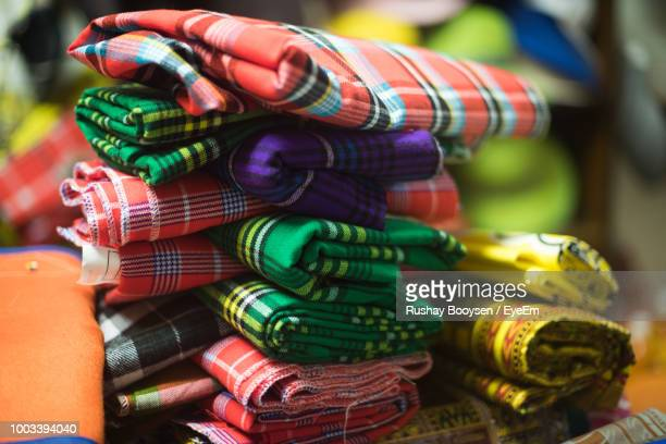 Close-Up Of Colorful Folded Fabrics For Sale In Market
